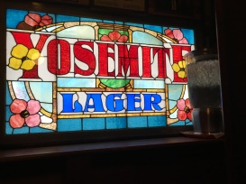 Stained glass beer ad inside Vesuvio's, San Francisco.