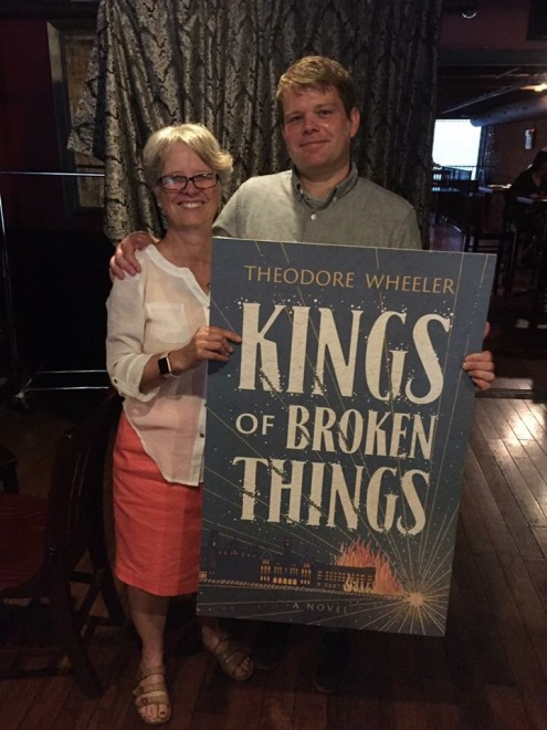 My mom and me with a giant book cover.